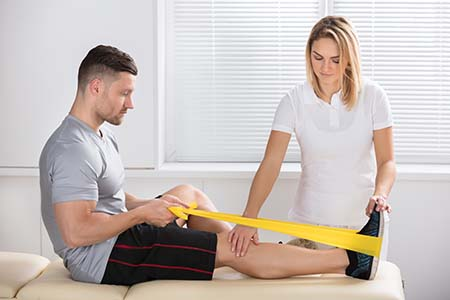 Physiotherapist using different techniques to help a patient recover